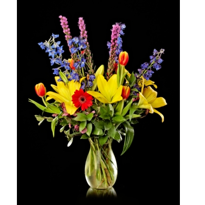 Ninth Street Flowers Durham - Grand and vibrant, this cascade of flowers is cheerful and bright. Colorful, fresh spring flowers make this a great gift for any occasion.
