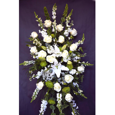 Ninth Street Flowers Durham - Classic white flowers have a peacefulness and purity to them, bringing hope and light during a time of loss. Our impressive standing spray arrangement is meticulously handcrafted with an abundance of pristine white blooms for a lush, full presentation.
