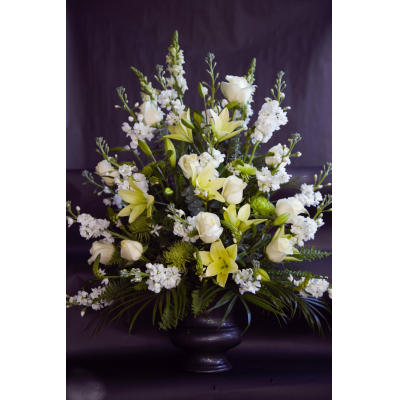 Ninth Street Flowers Durham - Classic white flowers have a peacefulness and purity to them, bringing hope and light during a time of loss. Our impressive urn arrangement is meticulously handcrafted with an abundance of white blooms for a lush, full presentation