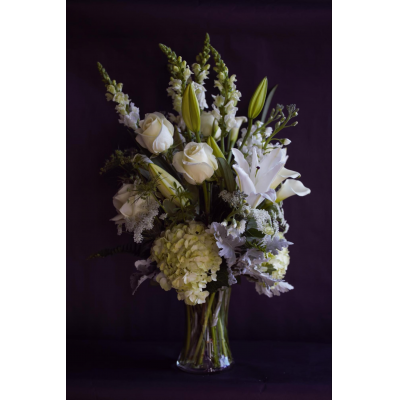 Ninth Street Flowers Durham - A magnificent and unforgettable tribute. featuring white and green seasonal flowers.This design is custom made using our most inspirational stems of the day. Please note that the image shown is meant to approximate a typical piece, however each arrangement will vary.