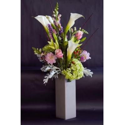 Ninth Street Flowers Durham - The pinks and whites of this arrangement will add a soft enchantment to any space. It includes elegant blooms such as Oriental Lilies.