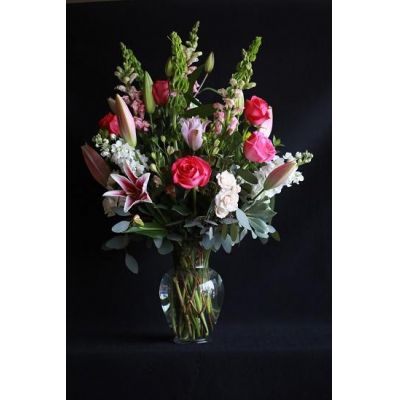 "Ninth Street Flowers Durham - ""With their graceful beauty and sweet fragrance, lilies are sophisticated and say everything that's in your heart. Start with delicate Oriental lilies accompanied by a beautiful selection of assorted pink, white and purple blossoms. """
