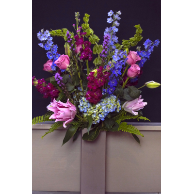 Ninth Street Flowers Durham - An enticing and sensual mix of fragrant lilies, roses, stock, and other seasonal favorites, makes this one of our best selling choices. As pictured this is our average size arrangement.    PLEASE NOTE: Vase will vary from the one shown in the photo.
