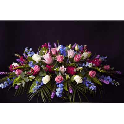 "Ninth Street Flowers Durham - ""A tastefully sophisticated arrangement that adds a rich and colorful display to the memorial service. Nature's most beautiful flowers create an endearing and cherished tribute to your loved one. Picture here is our magenta, pink and dark blue casket spray. If you would rather have a different set of colors, please note that in your order or call our store to find out what is seasonally available. """