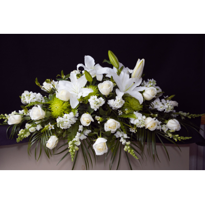Ninth Street Flowers Durham - Convey your heartfelt sympathy with a timeless display of all white. This casket spray with its array of white roses, white oriental lilies, stock and best available white flowers will drape the casket elegantly as a final and respectful tribute to your loved one.