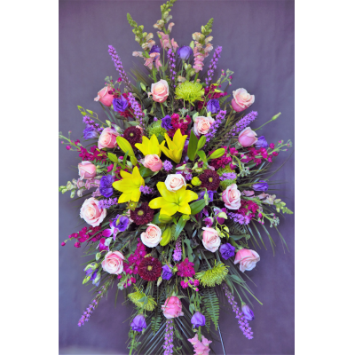 """Ninth Street Flowers Durham - """"Celebrate a special life with this colorful combination of nature's rainbow of colors. An unforgettable array of flowers brings radiance and majesty in honor of a life well lived. Yellow and pink are featured in this picture. If you prefer a different set of colors, please note that as you place your order or call our store for what is available. """""""