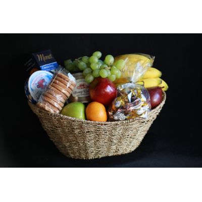 Ninth Street Flowers Durham - A Basket full of gourmet favorites both sweet and savory along with select fresh fruits is sure to give a hearty greeting! Exact items may vary. Must have 24 hour notice for delivery.