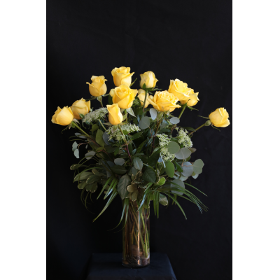 Ninth Street Flowers Durham - Roses are the classic, most recognizable of all flowers, and considered to be the flower of great affection. We offer a flawless selection of truly long-stemmed roses, accented with seasonal foliage. Order One Dozen (Standard), Two Dozen (Premium) or Three Dozen (Wow!) Choose yellow as shown, or the color that will be most appreciated by the recipient.    PLEASE NOTE: Vase may be different than the one shown in the photo.