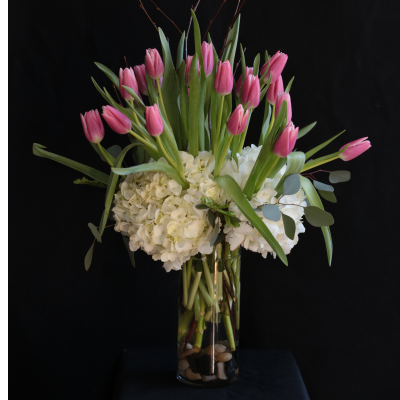 Ninth Street Flowers Durham - Spring fresh tulips, embellished with hydrangea stems & additional greenery.
