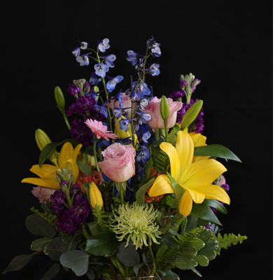 Ninth Street Flowers Durham - This grand, vibrant cascade of flowers is cheerful and bright. A best seller, the colors of spring make this arrangement the perfect gift for any occasion.