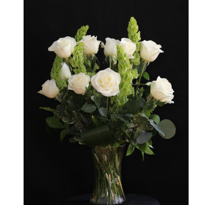 Ninth Street Flowers Durham - A tasteful display of long stemmed white roses, accented with Bells of Ireland