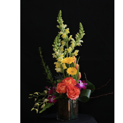 Ninth Street Flowers Durham - A dramatic vertical display made up of Snapdragons, Roses, Gerber (Gerbera) Daisies, Tulips & Dendrobium Orchids, in vibrant spring colors.