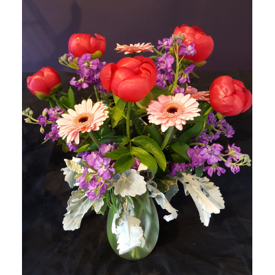 Ninth Street Flowers Durham - Peonies are a long-anticipated spring flower. Make mom feel like a queen with a lush display of fragrant peonies beautifully arranged with gerberas and stock. Available for only a limited time.