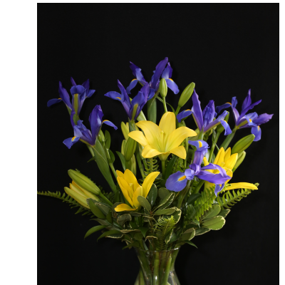 Ninth Street Flowers Durham - A grouping of bright local lilies, enhanced with complementary color irises.