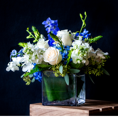Ninth Street Flowers Durham - A delightful array of blue and white blooms arranged in a square glass vase.
