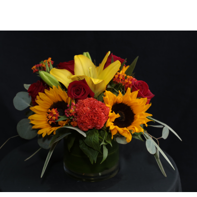Ninth Street Flowers Durham - A tight, European style arrangement featuring sunflowers, roses and celosia