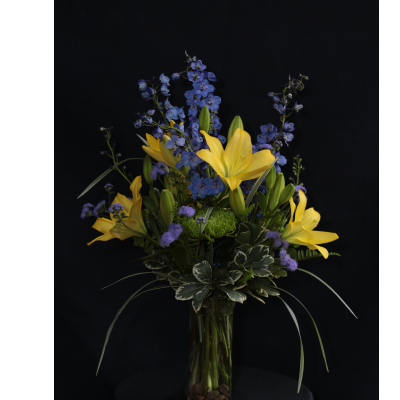 Ninth Street Flowers Durham - A refreshing arrangement featuring yellow Asiatic lilies accented with cool blue delphiniums.