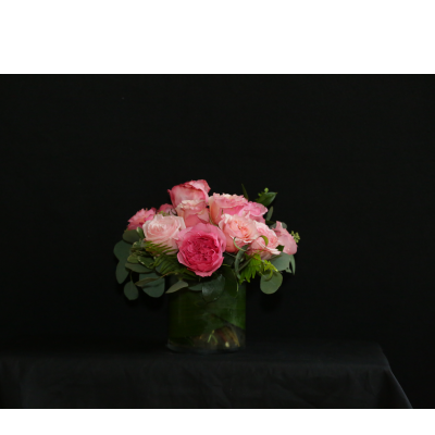 Ninth Street Flowers Durham - A gathering of garden roses in a glass container, tightly arranged to grace your Thanksgiving table. Rose color will vary, based on the freshest available flowers. Add a taper candle for $4 to enhance the holiday feeling.   Order by noon on Tuesday, November 26 to ensure Thanksgiving availability.
