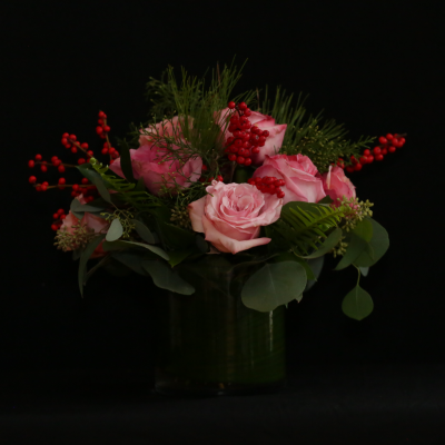 Ninth Street Flowers Durham - A tightly packed arrangement of garden roses, garnished with festive Christmas elements. Colors may vary, depending upon availability of the freshest flowers.   Add a taper candle to create an even more festive holiday display.