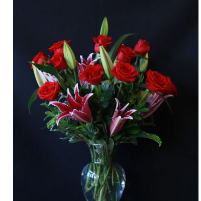 Ninth Street Flowers Durham - Beautiful roses and long lasting, locally grown fragrant lilies combine to make an elegant and gorgeous arrangement.