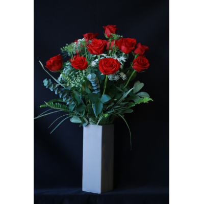 Ninth Street Flowers Durham - Roses are the classic, most recognizable of all flowers, and considered to be the flower of great affection. We offer a flawless selection of truly long-stemmed roses, accented with seasonal foliage. Order One Dozen, Two Dozen, or Three Dozen   PLEASE NOTE: Vase may be different than the one shown in the photo.