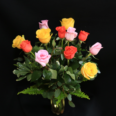 Ninth Street Flowers Durham - Three summer-toned colors of long-stemmed roses, accented with lush mixed green foliage.