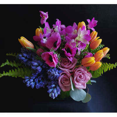 Ninth Street Flowers Durham - Greet Spring with this European compact styled arrangement of seasonal blooms.