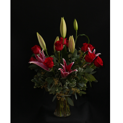 Ninth Street Flowers Durham - Beautiful roses and long lasting, locally grown fragrant lilies are gorgeous together in a colorful display. Available with red, pink, or white roses.