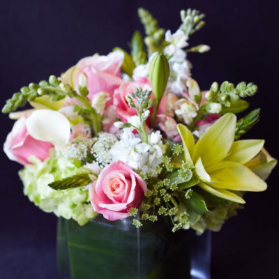 Ninth Street Flowers Durham - Soft pink roses, Asiatic lilies, and stock in a European Compact style is perfect for Mother's Day or for new parents celebrating the birth of a new baby girl.