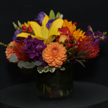 Ninth Street Flowers Durham - A compact, European Style arrangement featuring Fall flowers in jewel tones.