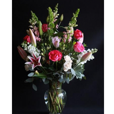 Ninth Street Flowers Durham - With their graceful beauty and sweet fragrance, lilies are sophisticated and say everything that's in your heart. Start with delicate Oriental lilies accompanied by a beautiful selection of assorted pink, white and purple blossoms.