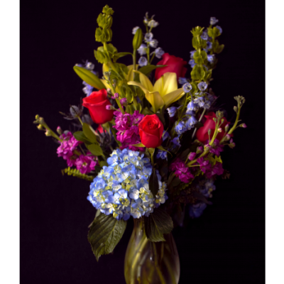 Ninth Street Flowers Durham - Classic or Traditional style arrangements are best known for being tall and showy. Our award winning florists pick an array of seasonal flowers and colors to showcase in a clear glass vase. A combination of feature flowers like lilies, gerberas and roses draw your eye to the arrangement. Select greenery provides a backdrop and accent flowers like snapdragons, freesia and alstromeria add height, depth and texture. This classic style has the feel of having just been picked from the garden.