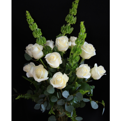 Ninth Street Flowers Durham - A tasteful display of all-white long-stemmed roses, accented with green Bells of Ireland.