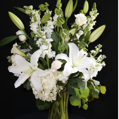Ninth Street Flowers Durham - White flowers have long represented humility and reverence, while also sending a message of loyalty and admiration. A magnificent and unforgettable arrangement featuring white and green seasonal flowers. When the occasion calls for an elegant and esteemed expression of your thoughts, this is a classic.